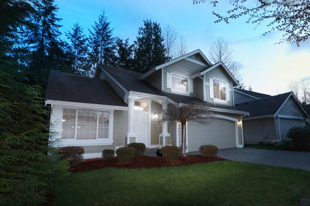 Buchan home on a private, serene lot next to a flowing creek. -