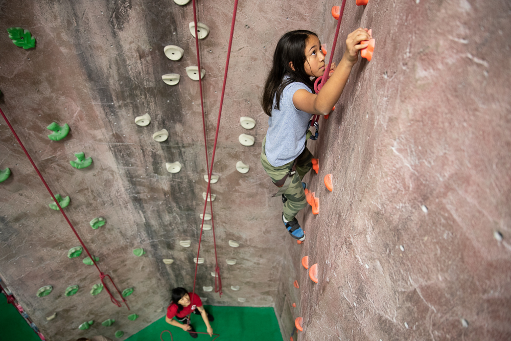 Climbing Skills + Technique - Our climbers learn the essential knots and belay skills, then work on building their repertoire of movement and technique through drills and games.