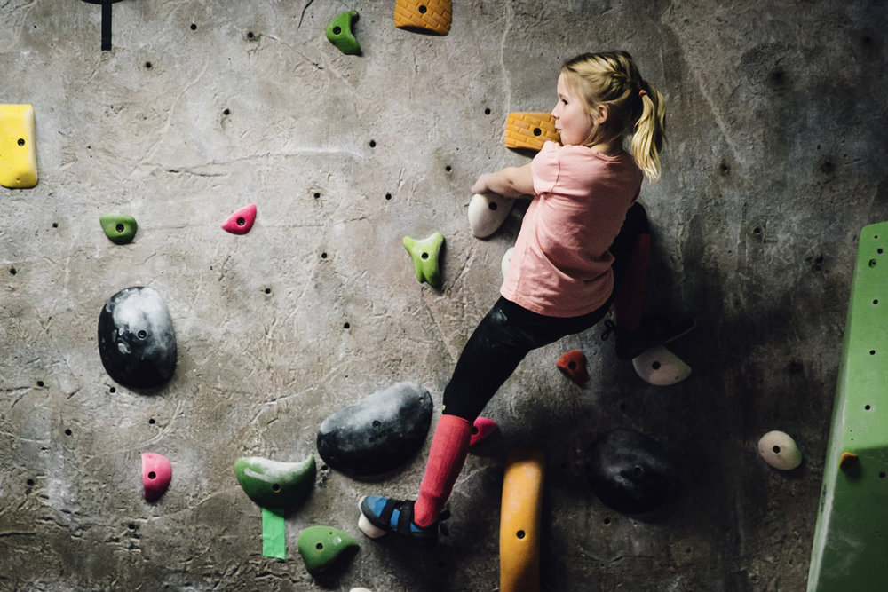 Climbing - An irresistibly fun activity for all ages and levels. Climb color coded routes to reach the top!