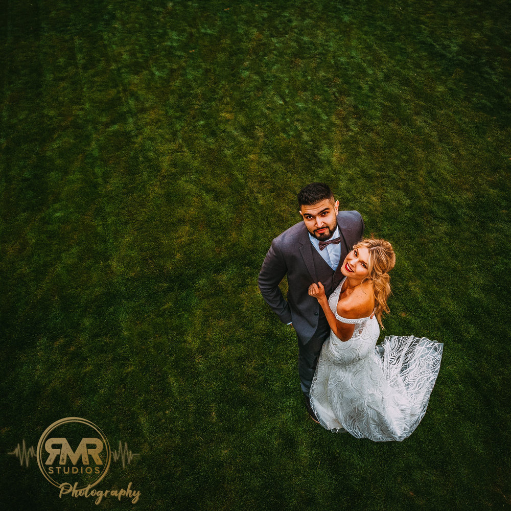 Bride and Groom looking at drone angled-1.jpg