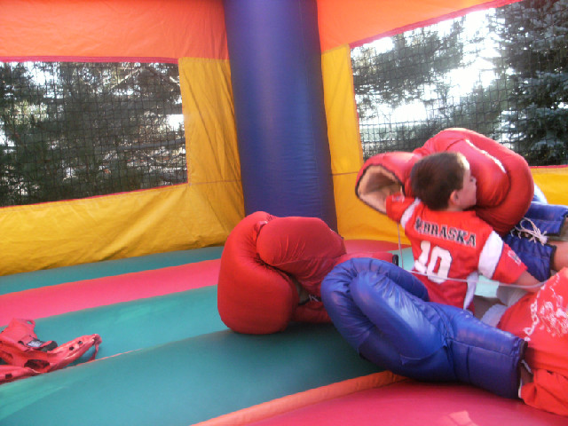 Add oversized Boxing Gloves to any Bounce House! -