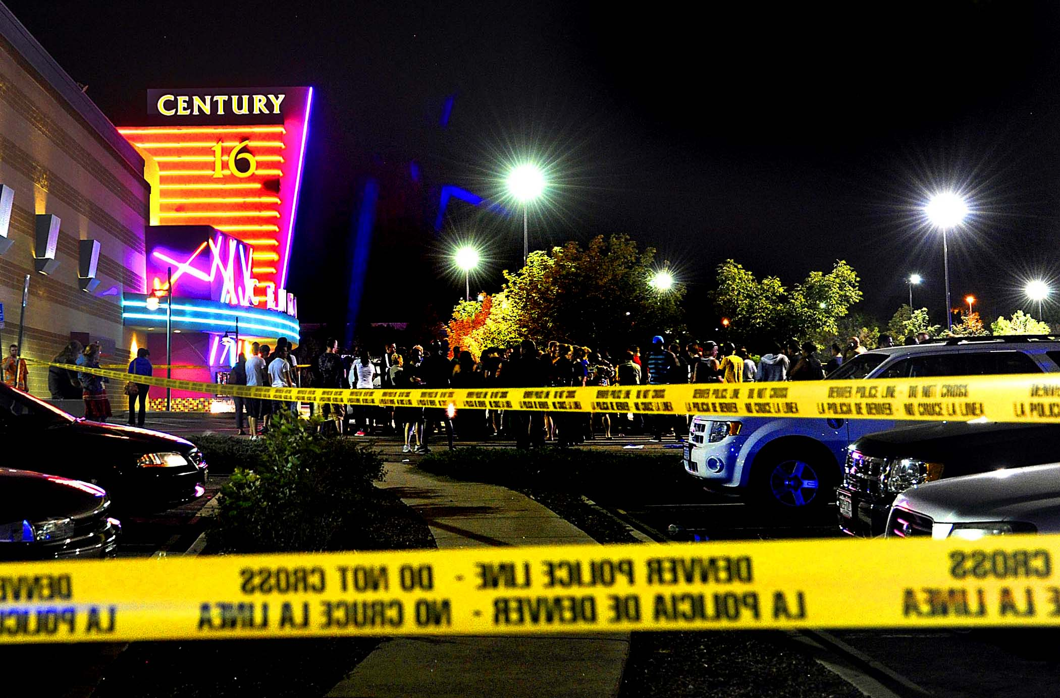 People gather outside the Century 16 movie theater in Aurora, Colorado, at the scene of the mass shooting. (Karl Gehring/Associated Press)