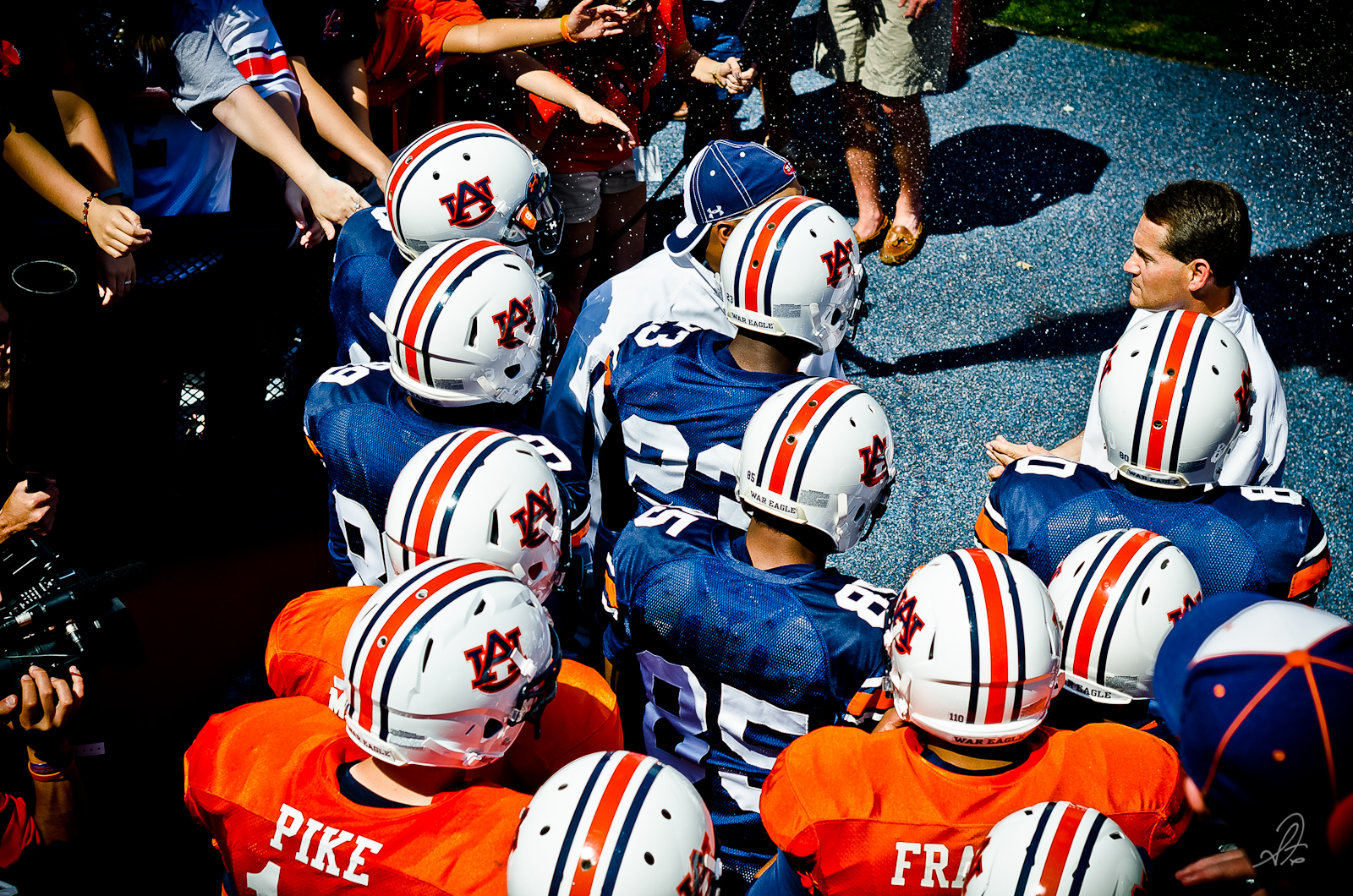 Auburn's Chizik and Trooper Talk to the Players Before Aday 2012