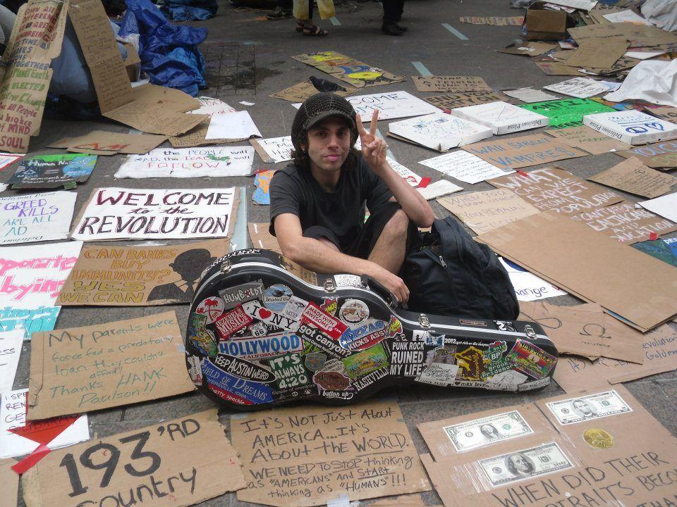 Matt Pless, a young folk singer at a peace rally in lower Manhattan. Photo credit: Karen Kramer.