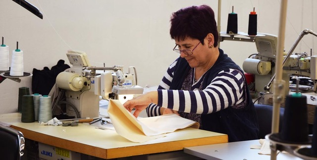 This is Gulumser! - She worked on most of our collections and believe us, no one enjoys sewing more than her! She puts so much love into her work.