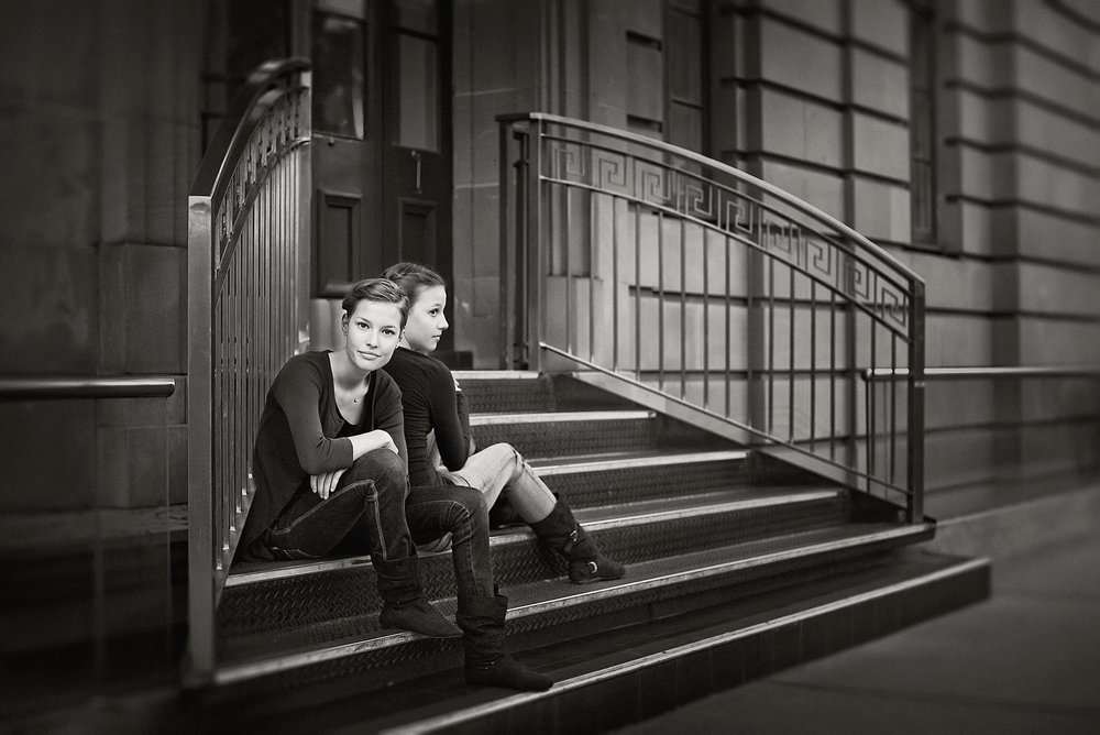 black and white family portrait of sisters-learn natural light portraiture.jpg