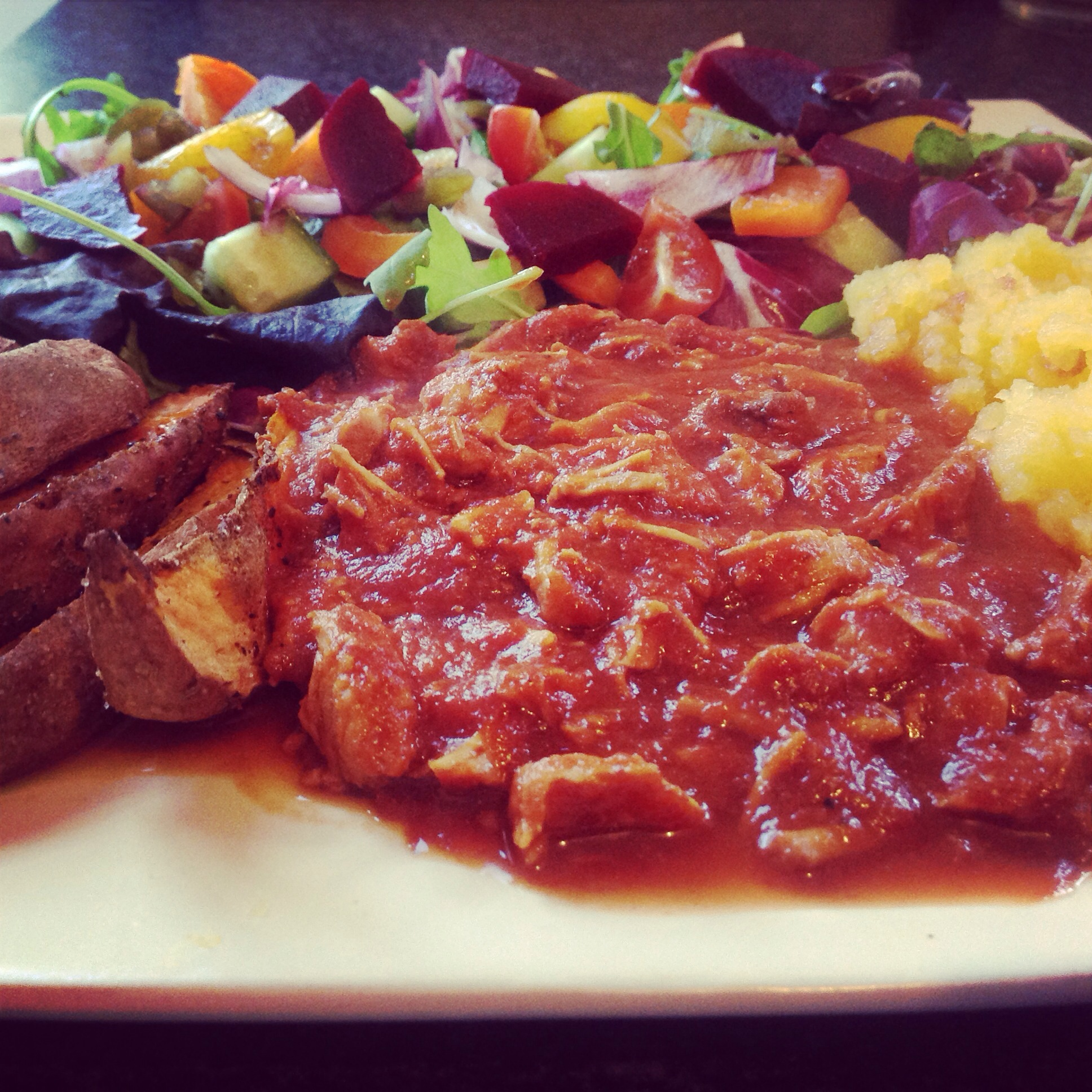 Pulled pork, sweet potato wedges and salad