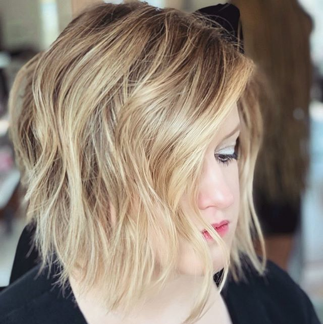 Haircut by Lead Stylist @shearsri79 for @brittney_durham_  This is not your mom's bob haircut. This fresh, collarbone-grazing, sexy cut has all of the chicness of a swingy bob with all of the messy texture & wildness you ❤️ #patriciahillcolorstudio #hairgoals