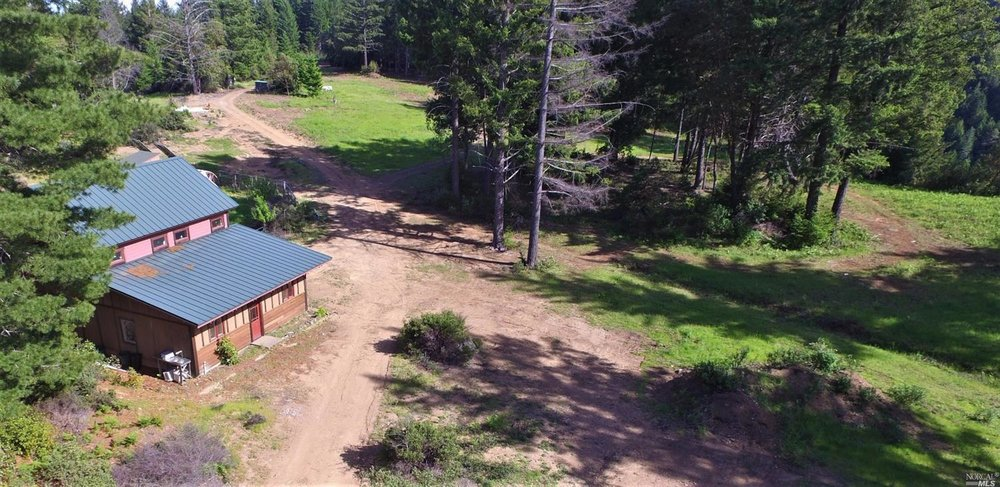 143 Acre Property on Mtn View Road with barn & guest house.  $650,000 Represented Seller