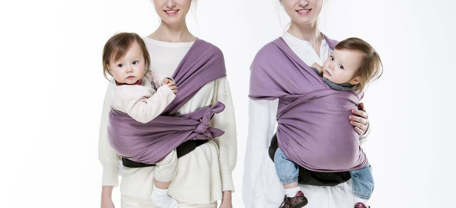 mom carrying a baby with baby wrap
