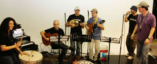 Negin Bahrami lays down a beat on the surdo along with guest musicians, from left: Avital Zemer (seven-string guitar), Carlos Cardozo (cavaquinho) and Wagner Petrilli (guitar).
