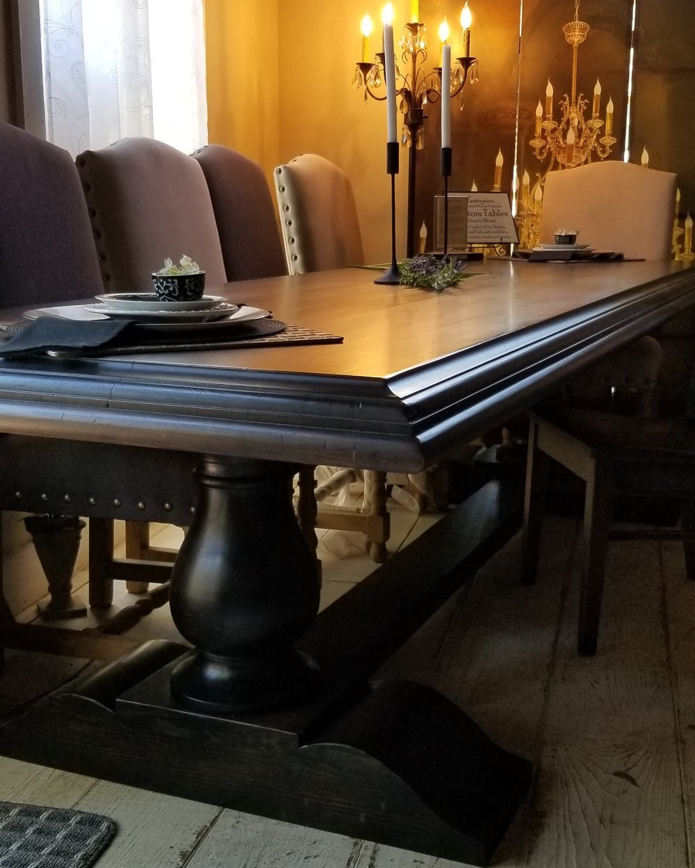 Baron's Table-The Baron's Table is another Masterpiece trestle table design. This table offers a classic-look ornate edge and is available in a selection of wood varietals and stain or paint colors.Pricing Starts at $2,695 for 7'. -