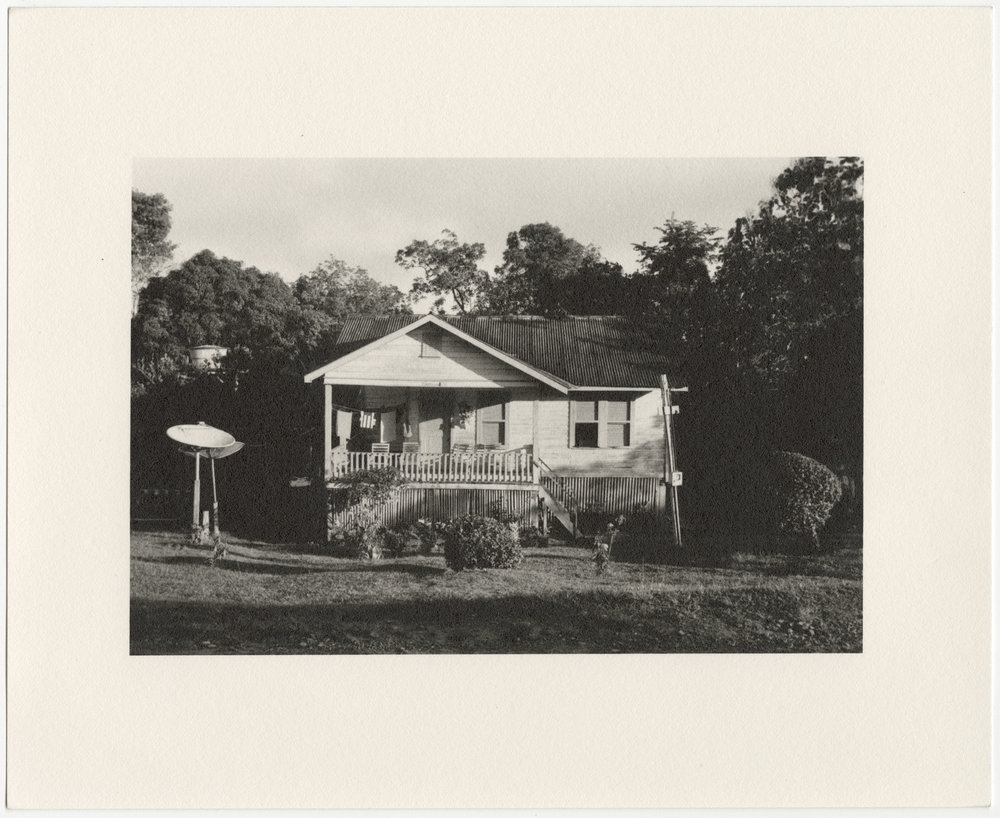 """Fordlândia employee house with satellites, built in 1929-1933 by the Companhia Ford Industrial Do Brasil Ford Motor Company. 2014, Fordlândia, Pará, Brazil. Gelatin silver fiber print, 8"""" x 10"""", 2014/2018"""