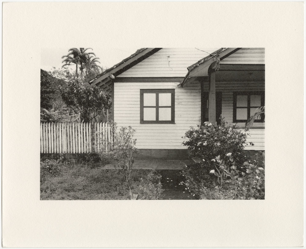 """Belterra employee house with window and white picket fence, built in 1934 by the Companhia Ford Industrial Do Brasil Ford Motor Company. 2014 Belterra, Pará, Brazil. Gelatin silver fiber print, 8"""" x 10"""", 2014/2018"""