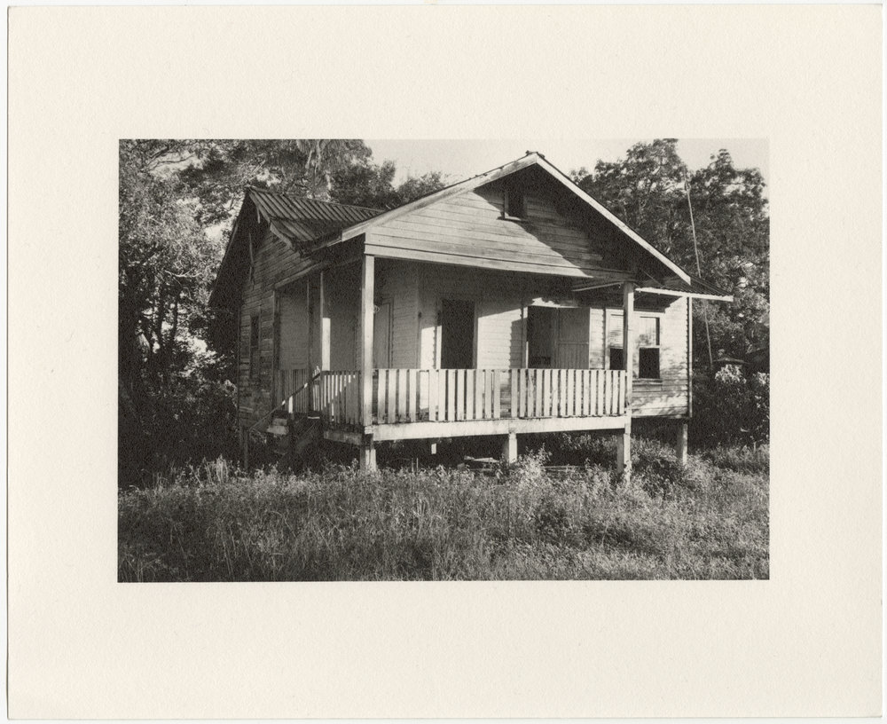"""Fordlândia employee house with elevated front porch, built in 1929-1933 by the Companhia Ford Industrial Do Brasil Ford Motor Company. 2014 Fordlândia, Pará, Brazil. Gelatin silver fiber print, 8"""" x 10"""", 2014/2018"""