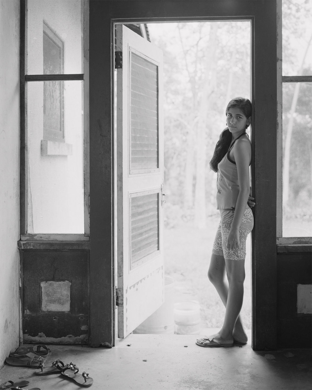 Késsia Souza, 14 years old in her home, original company housing built by Henry Ford employees, April, 2014, Fordlandia, Brazil. 2014/2018