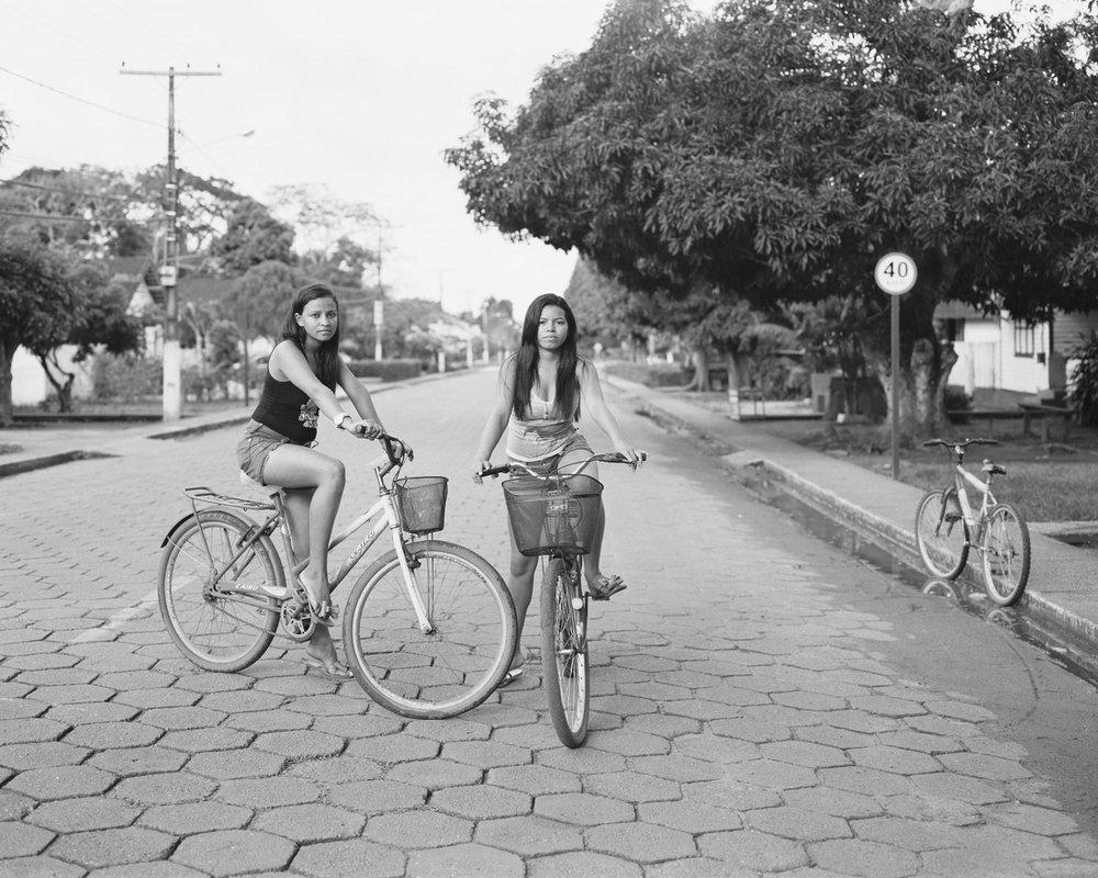 Nádhya Sophia and Loolinda Lee on bicycles, March, 2014, Belterra, Brazil. 2014/2018