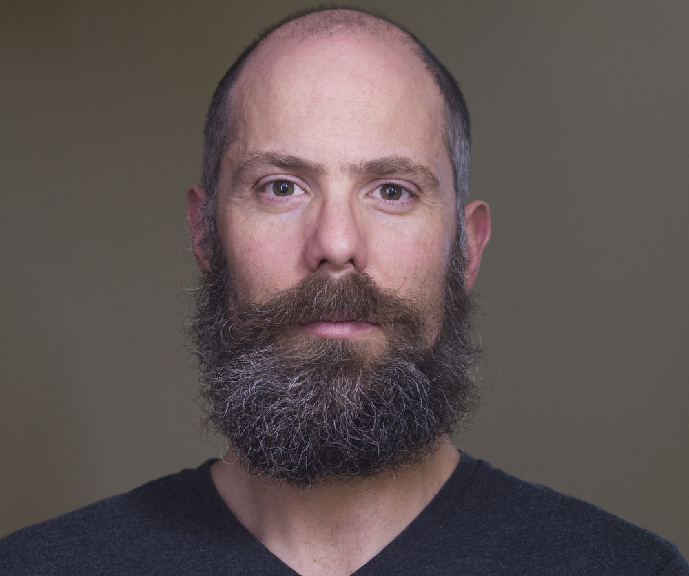 IAN KERR, CSC | INVENTOR - Ian is an Emmy award winning cinematographer and beard model.When he isn't shooting, he invents and designs stuff like the MultiTurret.
