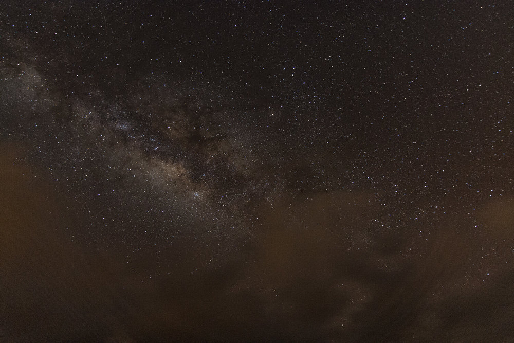 This was my first test shot at Grand Bay. Even though artificial lights were minimal, the few street lights along the boulevard gave my image a bad orange tint. That cluster of colors near the center is our Milky Way galaxy.