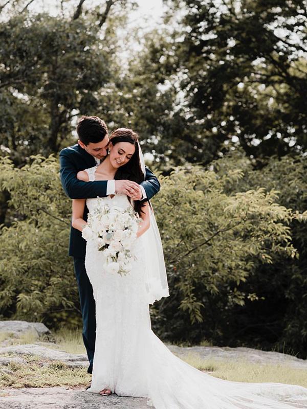 RR_600x800_dark brunette bride and groom on rock, trees.jpg