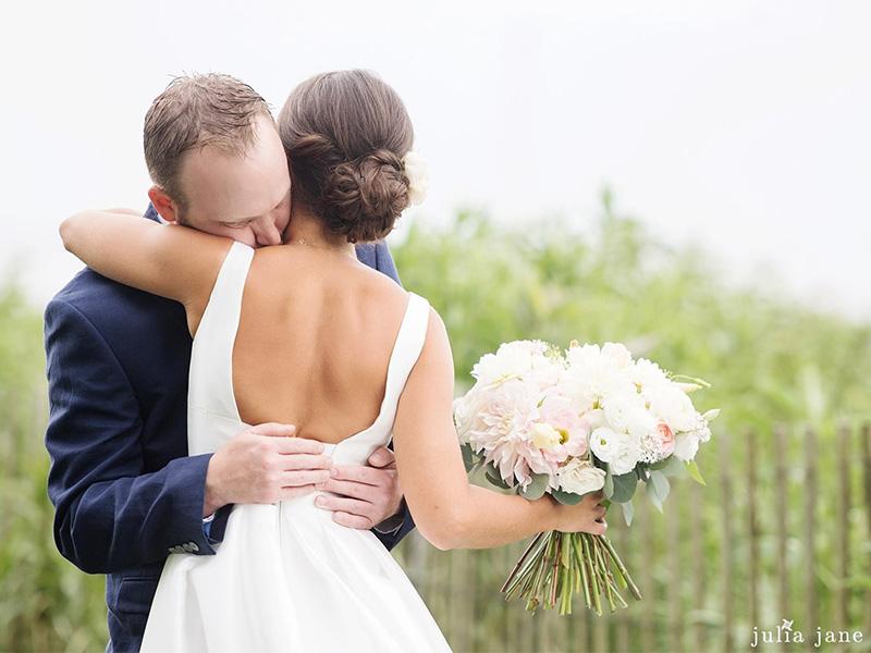 RR_800x600_brunette updo facing groom hug.jpg