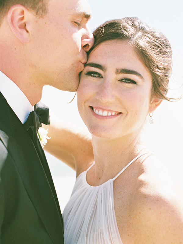 RR_600x800_groom kissing bride, sunshine and wind.jpg