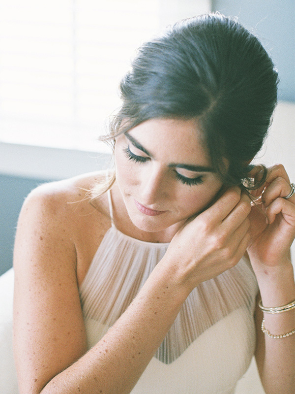 RR_600x800_bride, brunette, putting in earrings, 2.jpg