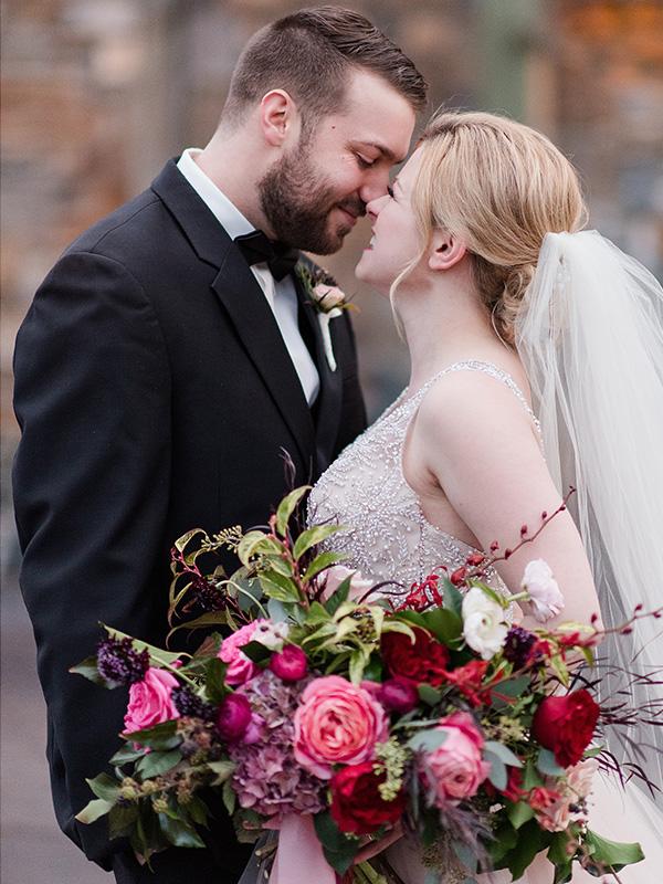 RR_600x800_wedding walkthru, bride and groom embrace, flowers.jpg