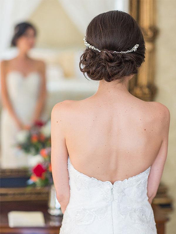 RR_600x800_back of hair, bride looking in mirror, hairpiece.jpg