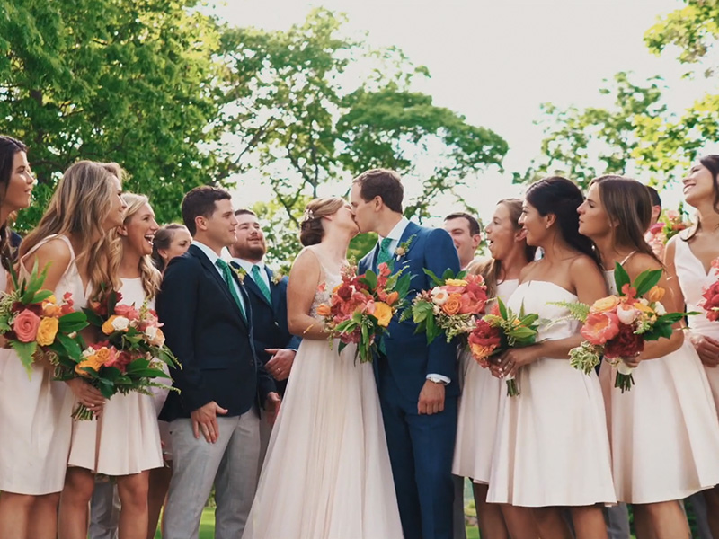 RR_800x600_brunette updo with wedding party kissing groom.jpg