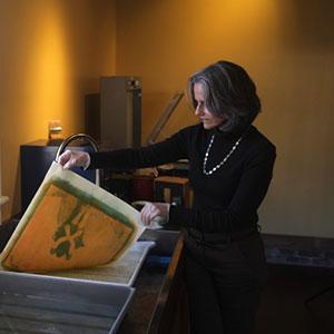 Diana Bloomfield working in her studio.