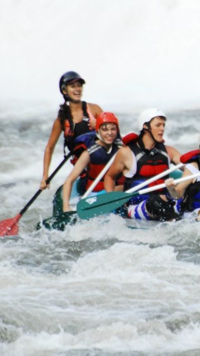 Adam (pictured middle) on his rafting trip, soon before he would learn of his diagnosis.