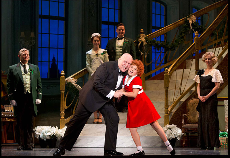 ANNIE-Gilgamesh-Taggett-as-Oliver-Warbucks-and-Issie-Swickle-as-Annie-in-I-Dont-Need-Anything-But-You-Photo-by-Joan-Marcus.jpg