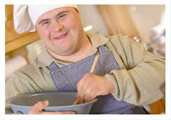 young man cooking and smiling