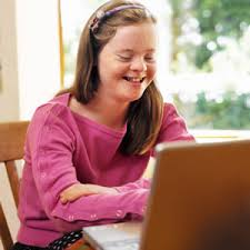 smiling child at computer