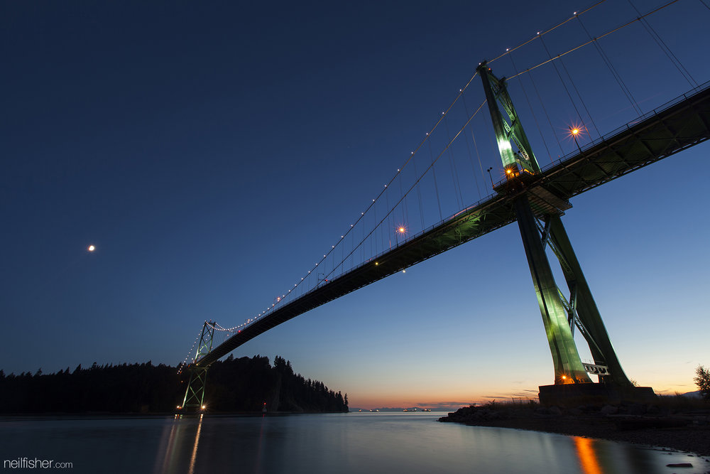 Completed in November 1939 by the Guinness family (of Irish beer fame), the bridge was later sold to the province in 1963. In 1986 the Guinness family, as a gift to Vancouver, installed decorative lights on the cross making it a distinct night time landmark. These massive 100-watt mercury vapour bulbs were replaced in 2009 with LED lights reducing the bridges' power consumption by 90%. The bridge spans 473 metres and stands 111 metres tall.  EXIF 30.0sec f/10.0 ISO 50 16mm August 4th 2014 21:23 West Vancouver, BC