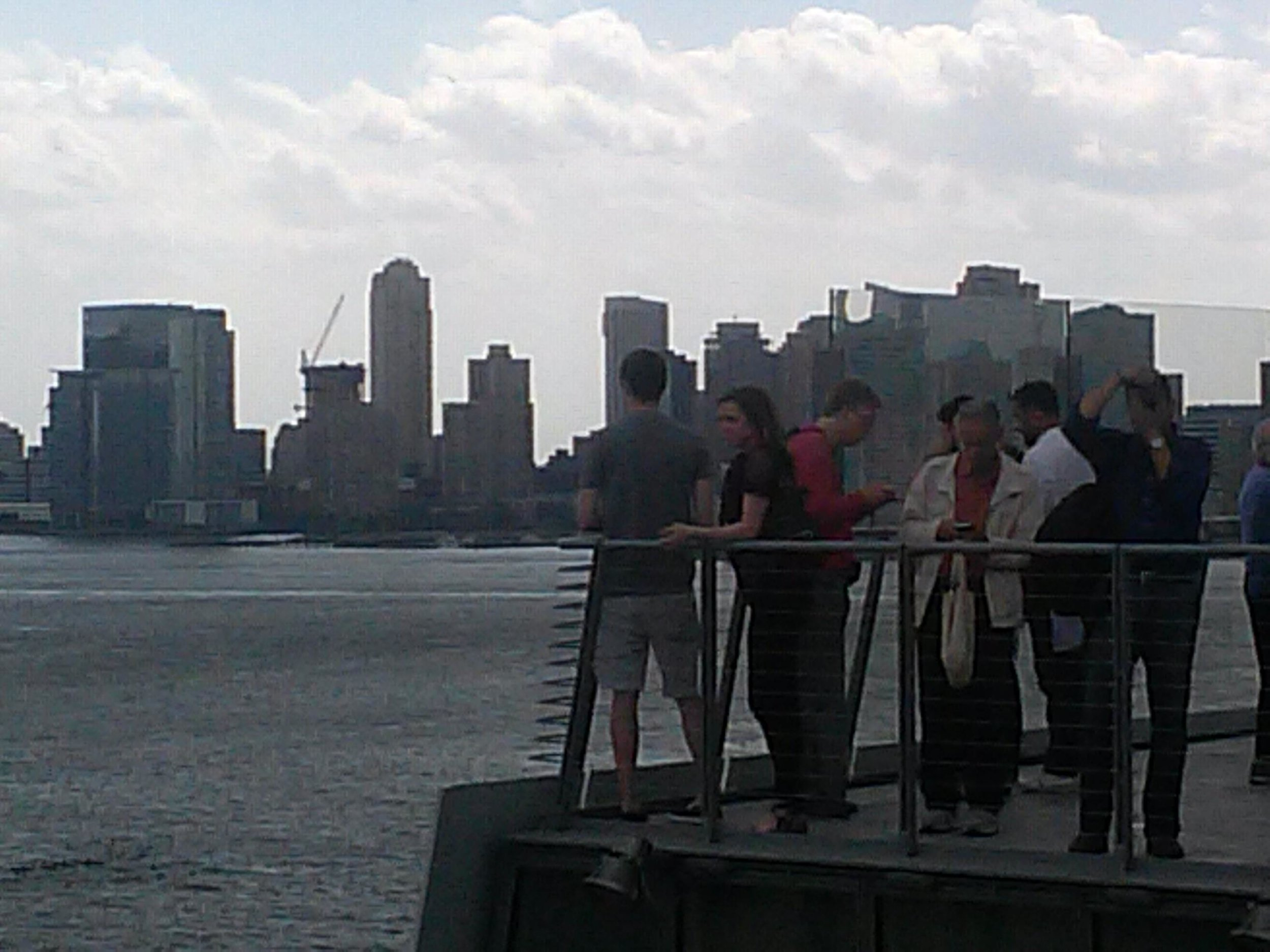 People at the Whitney overlooking Hudson River.