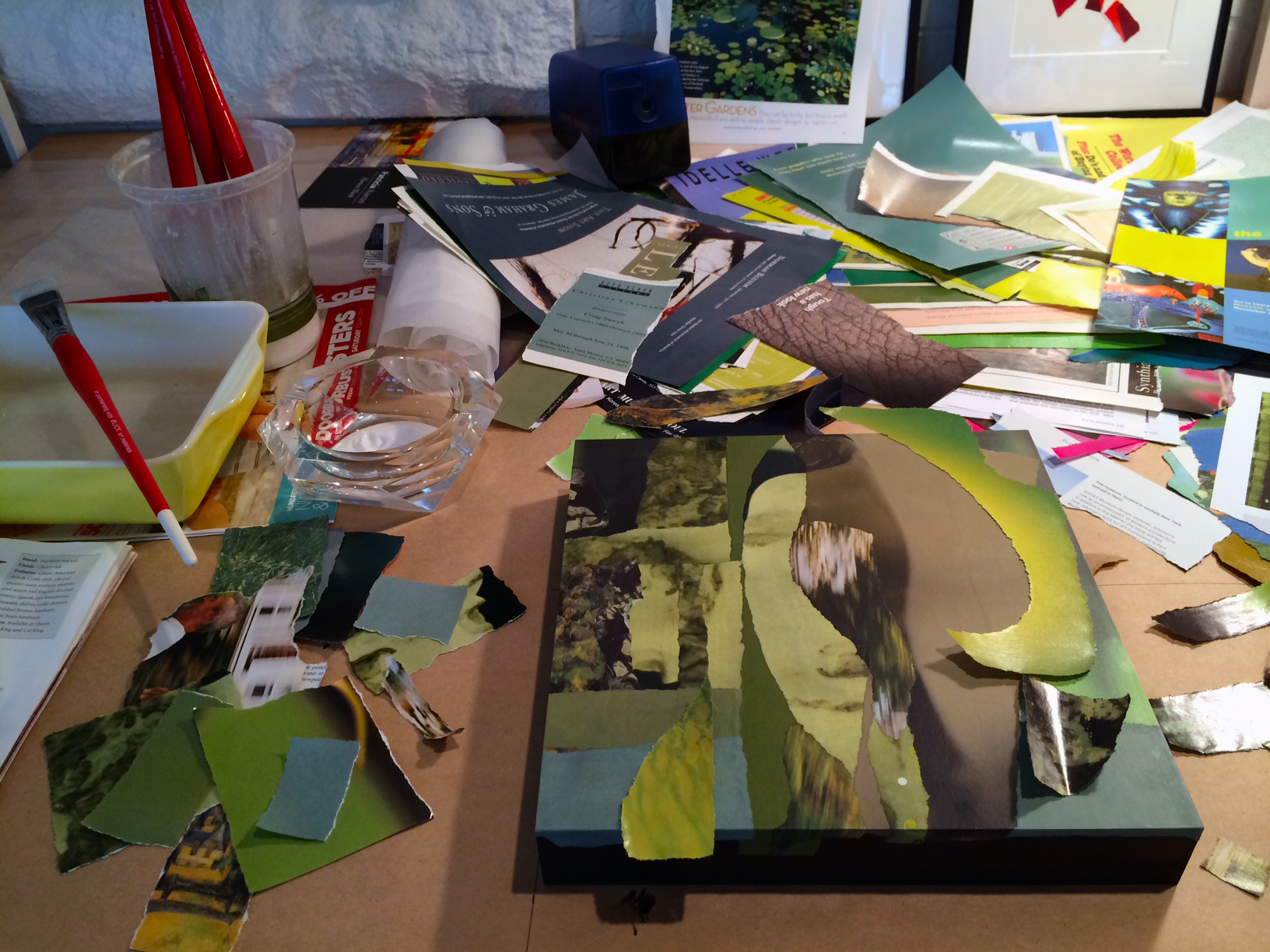 View of my work surface with collage in progress.
