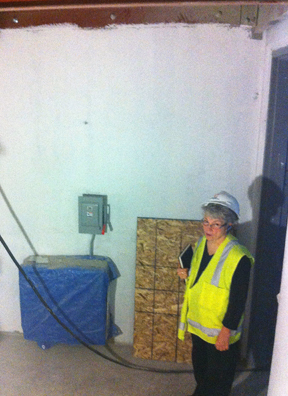Hilary discovers a box inexplicably mounted to center of level one wall, later relocated!