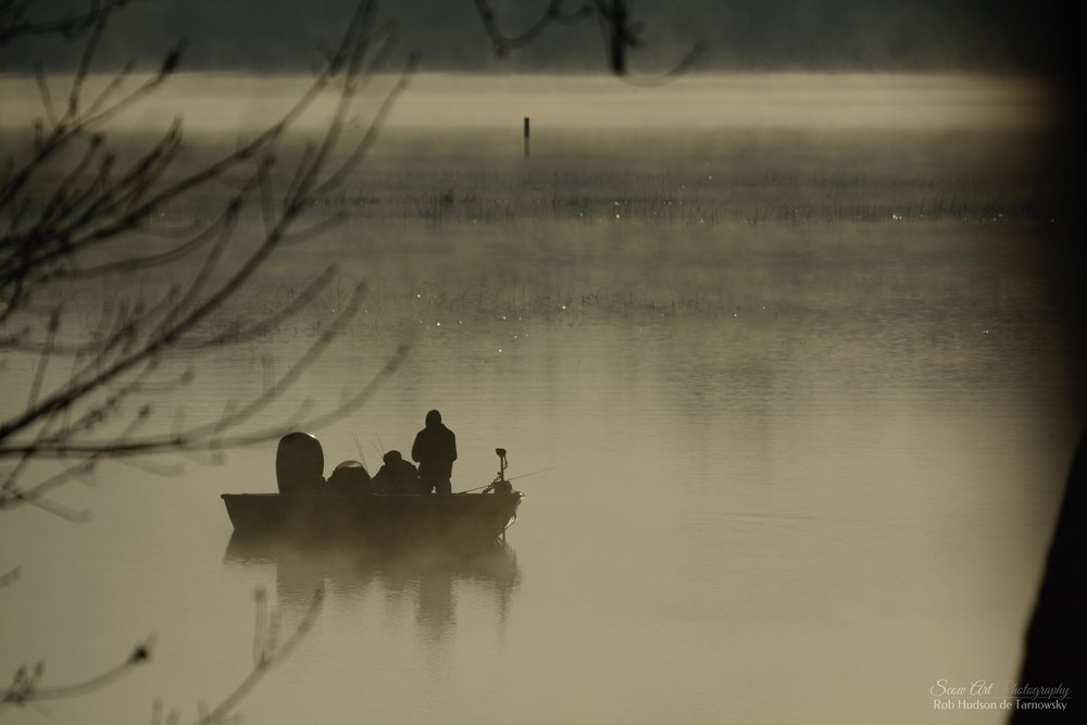 Fishermen in Beulah Cove by the main channel on Lake Beulah in early Spring 2019.
