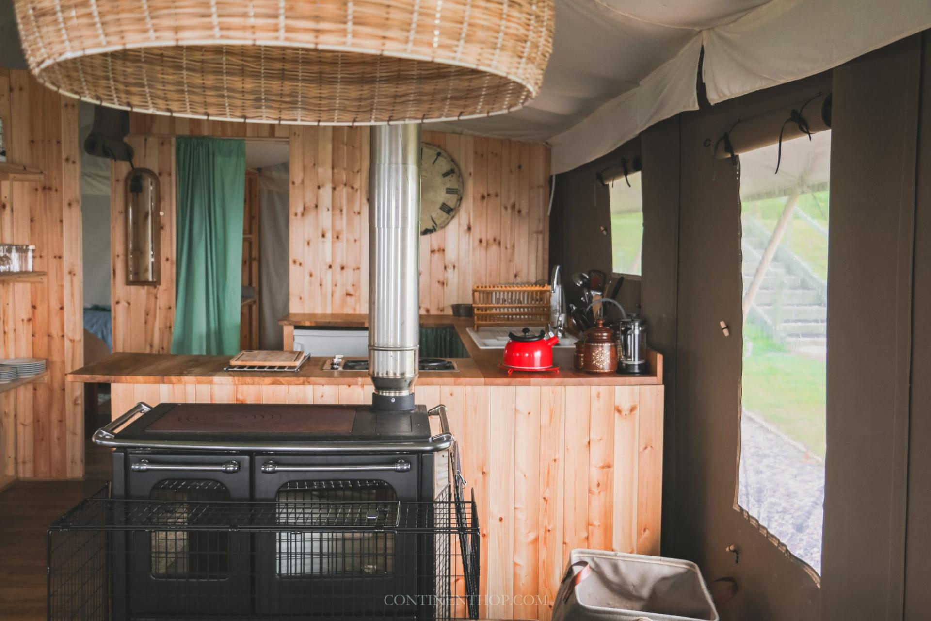 kitchen with wood stove inside glamping tent in fife scotland