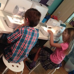 boys sewing and machine-sewing