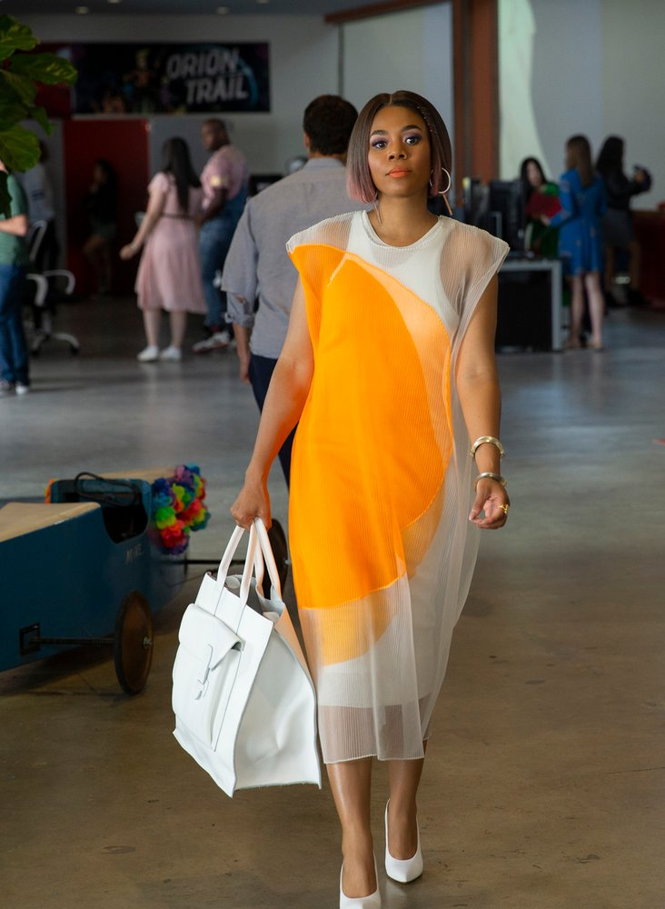 """Hall, as big Jordan, only goes through a handful of outfit changes before she turns little, and then only a couple more when she returns to her regular self, but they also help tell the story of her transformation. Her first look is a red-and-blue, pinstripe Virgil Abloh shirt (Hollowell made it a point to incorporate a number of Black designers, including Abloh, Cushnie, Romeo Hunte, Brother Vellies, and  Agnes Baddoo ), which she pairs with red pants. """"I had a discussion with Regina early on, and we were talking about the color red and how a lot of people are scared of it, but a lot of people love it, too,"""" she says. """"It means power, and most men, they wear these power red ties. Well, she's a powerful woman so let's go for this powerful red color."""""""
