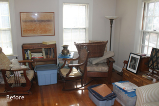 cluttered living room before home staging