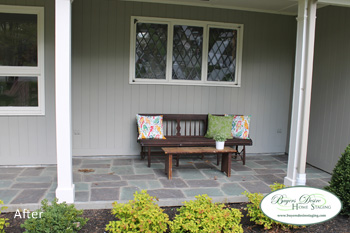 tidy, welcoming porch with bench