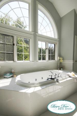 bath tub and wall of windows