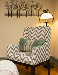 chair with sage green throw pillow