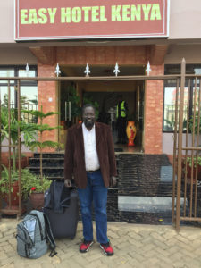 Picture of Jacob outside the Easy Hotel Kenya.