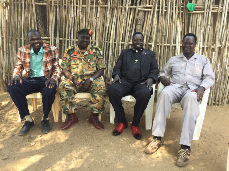 L to R: my cousins, a professor at the University of Juba, an Army General, myself, and another Army General
