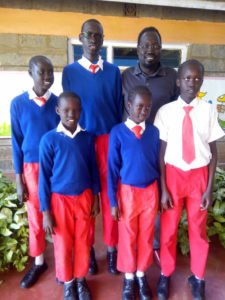 Jacob and some of the school children receiving support from the United States. Nairobi, Kenya.